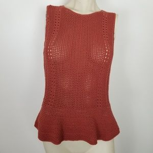 Ann Taylor loft burnt orange peplum knit top.